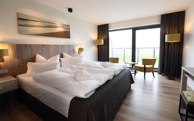 Komfortzimmer mit Elbblick Schlafzimmer mit Doppelbett